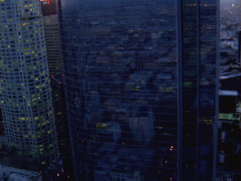 close aerial fly-by of towers in downtown los angeles. - artbeats stock videos & royalty-free footage