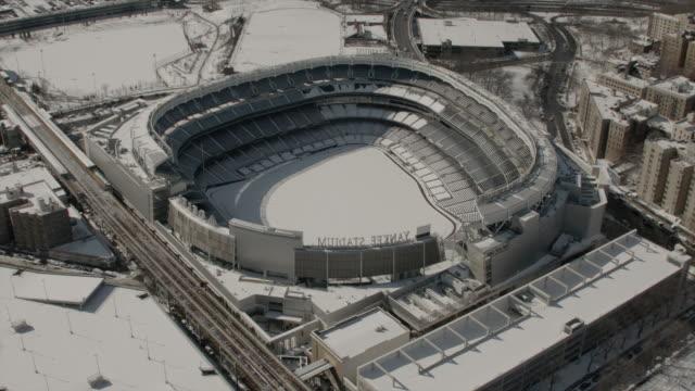Close Aerial View Of Yankee Stadium Panning Up To Reveal New York City