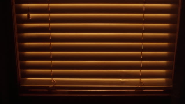 vídeos y material grabado en eventos de stock de close angle of blinds going up in front of window. window sill in fg. - persiana decoración