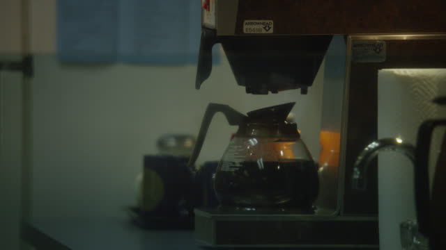 close angle of coffee pot or coffee maker in kitchen. could be in office.