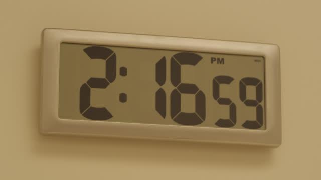 close angle of digital clock on wall. - digital clock stock videos & royalty-free footage