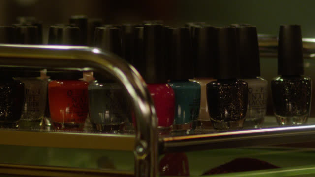 close angle of nail polishes in nail salon. - マニキュア液点の映像素材/bロール