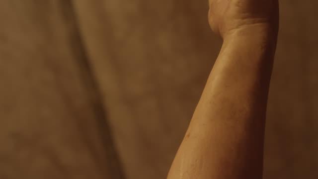 close angle of snake near person's arm. - braccio umano video stock e b–roll