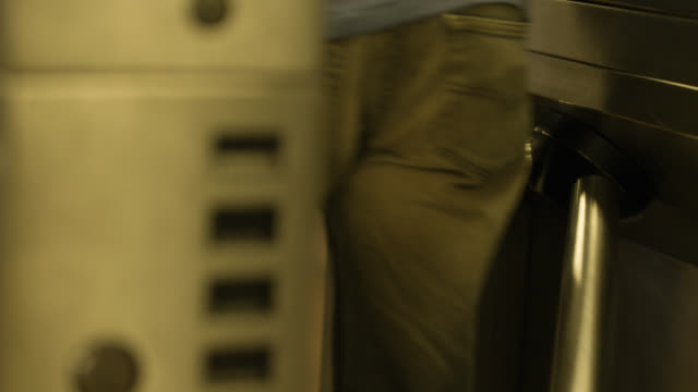 close angle of subway station turnstile. commuter partially visible. - 自動改札機点の映像素材/bロール