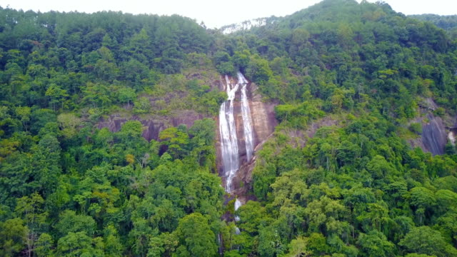 close approach to waterfall aerial view from drone in rain forest, siriphum waterfall in chiangmai, thailand. - calendar date stock videos & royalty-free footage