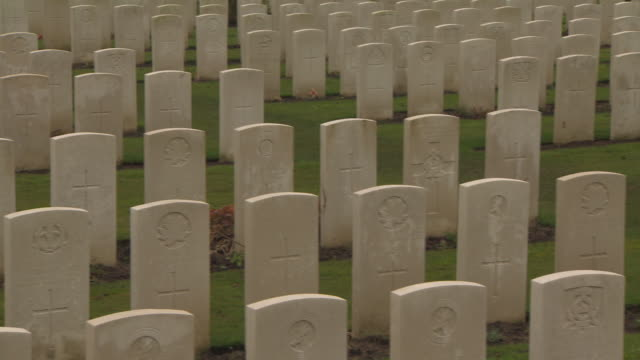 close crane shot tracking left over the gravestones of soldiers and sailors who died in wwi, tyne cot commonwealth war graves cemetery, belgium. - full frame stock videos & royalty-free footage
