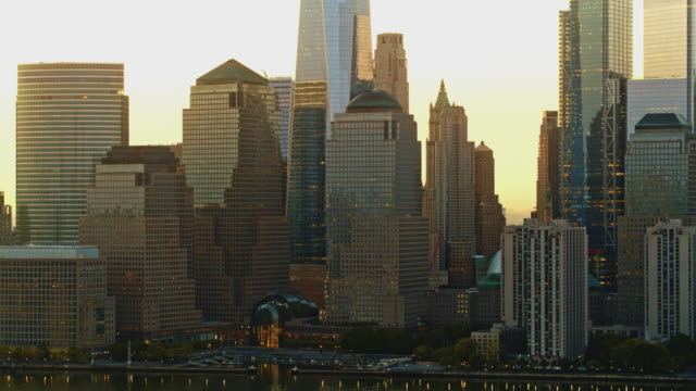 close distance view of manhattan downtown from hudson river at the sunrise. aerial footage with the cinematic panning camera motion. - sequential series stock videos & royalty-free footage