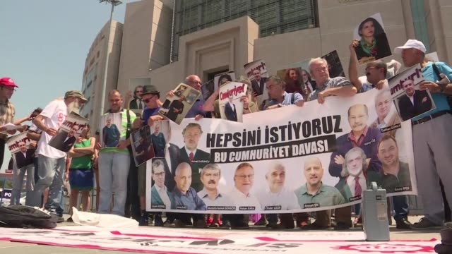 close family members of the cumhuriyet journalists reporters who were detained last year and a dozen of whom have now spent more than eight months in... - dozen stock videos & royalty-free footage