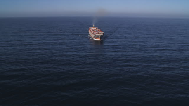 Close flight over a container ship in open ocean