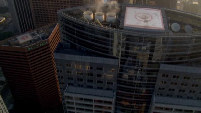close flight over skyscrapers to walt disney concert hall in los angeles. shot in 2008. - disney stock videos & royalty-free footage