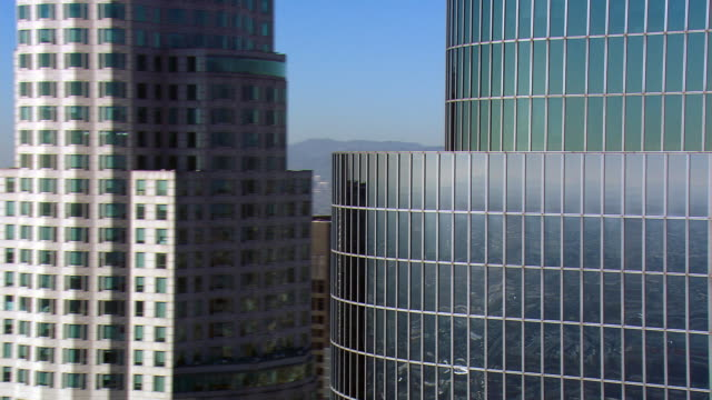 close flight past layered skyscrapers of downtown los angeles. shot in 2008. - skyscraper stock videos & royalty-free footage