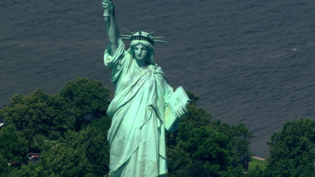 Close flight past Statue of Liberty to zoom-out. Shot in 2003.