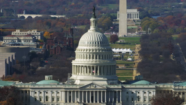 close flight past the capitol with the mall, washington monument, smithsonian castle, and lincoln memorial in rear; library of congress passing through frame in front. shot in 2011. - senate stock videos & royalty-free footage