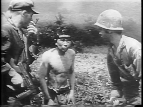 close image of japanese face / american soldiers using flamethrowers to set fire to bushes / flamethrowing tanks shoot fire on brush / japanese... - prisoner stock videos & royalty-free footage