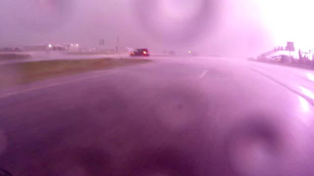 vidéos et rushes de close lightning strike - car pov - orage