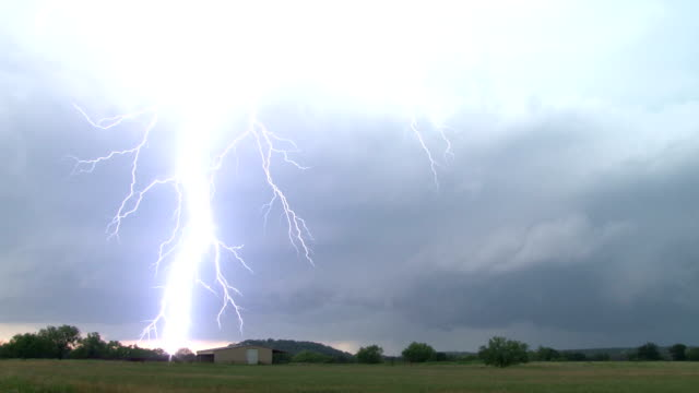 close lightning strike - supercell thunderstorm - forked lightning stock videos and b-roll footage