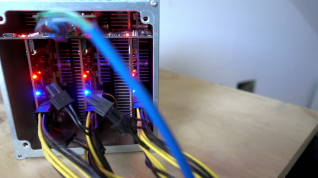 a close look at an asic bitcoin mining computer - cryptocurrency mining stock videos & royalty-free footage