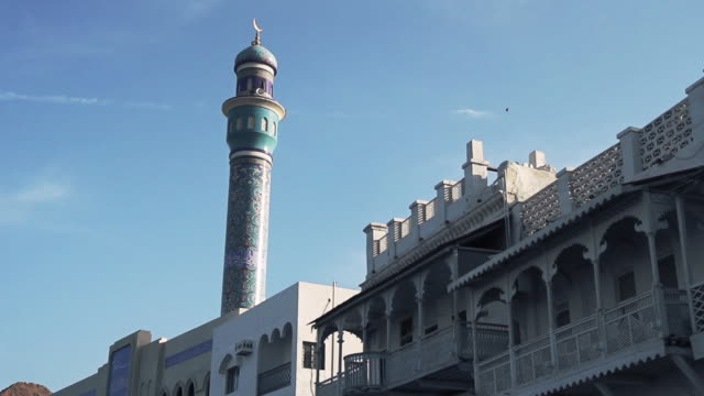 close motion shot of minaret of central mosque in mutrah, muscat, oman - oman stock videos & royalty-free footage