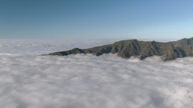 close pan across a sea of rolling clouds - madeira stock videos and b-roll footage