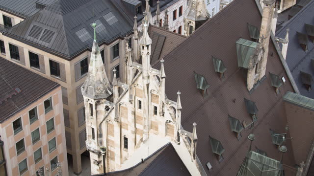 close pan over new townhall roof with new gothic spikes - ペディメント点の映像素材/bロール
