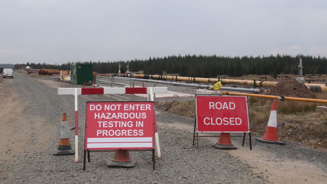 close road near constriction site of the new hydrogen test facility, operated by national grid plc and northern gas networks ltd. on the dnv group... - western script stock videos & royalty-free footage