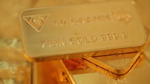 close shot 50 gram gold bar at gold investments ltd bullion dealers in london close shot bars of silver and gold with silver bars marked with serial... - ingot stock videos & royalty-free footage