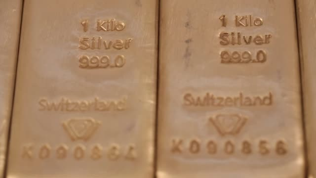 Close shot bars of onekilogram silver bars at Gold Investments Ltd bullion dealers in London 1 kilo silver bars branded 'Metalor' A one kilo gold...