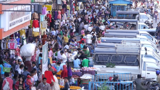 close shot. busy street in front of shopping mall in mandalay, myanmar - myanmar stock videos and b-roll footage
