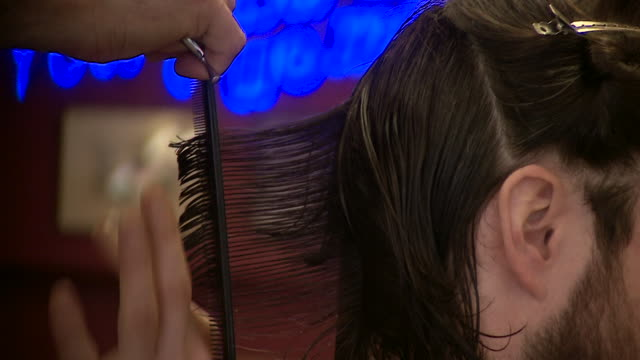 close shot of a barber cutting a customers hair. - scissors stock videos & royalty-free footage