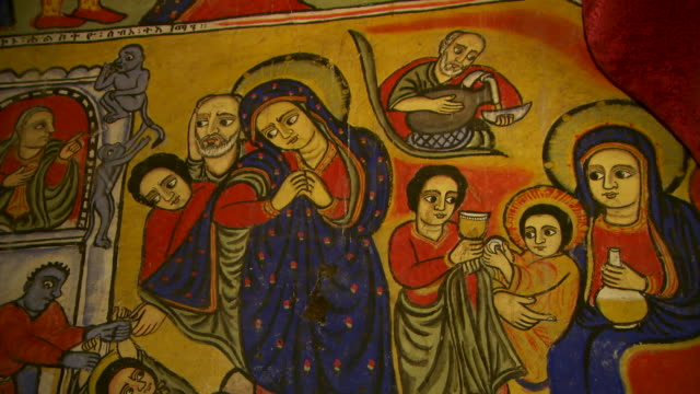 Close shot of a beautifully painted wall panel depicting Christian imagery in the church of Azuwa Maryam at Lake Tana.