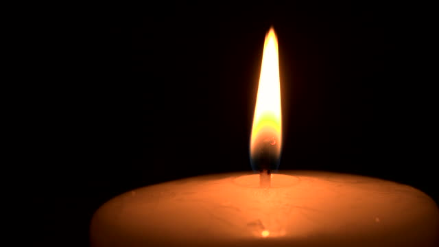 close shot of a burning candle wick. - ローソク点の映像素材/bロール