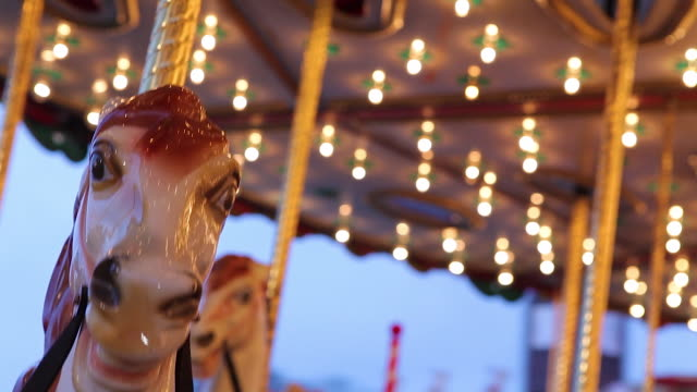 Close shot of a carousel horse moving up and down.