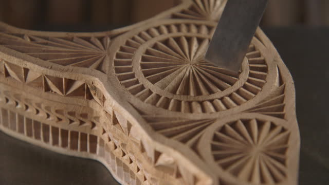 close shot of a carpenter using a chisel on an intricate wooden box. - chisel stock videos and b-roll footage