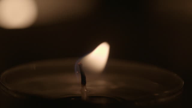close shot of a flickering tea light. - candle stock videos & royalty-free footage