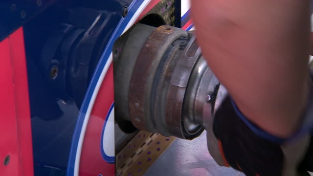 Close shot of a fuel pipe being attached to the Bloodhound supersonic car
