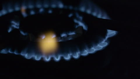 close shot of a gas burner igniting on a stove hob. - flame stock videos & royalty-free footage