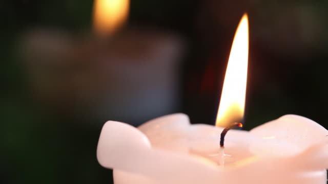 Close shot of a lit candle.