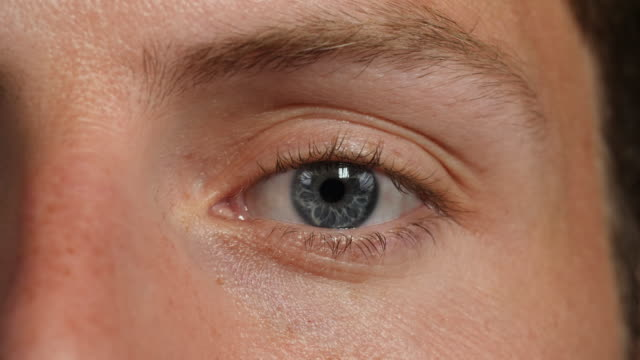 close shot of a man's left eye. - human face stock videos & royalty-free footage