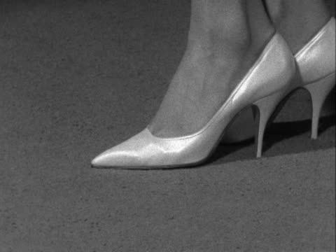 close shot of a pair of high heeled shoes. - scarpe video stock e b–roll