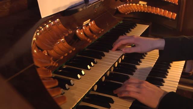 close shot of a person playing a church organ. - piano key stock videos & royalty-free footage