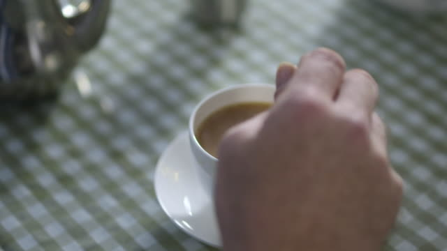 close shot of a person stirring a cup of tea. - tea cup stock videos & royalty-free footage