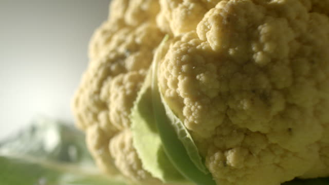 close shot of a revolving cauliflower. - cauliflower stock videos & royalty-free footage