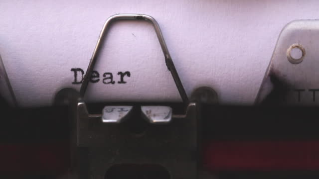 "close shot of a typewriter typing the words ""dear sir/madame"" on a sheet of paper. - english language stock videos and b-roll footage"