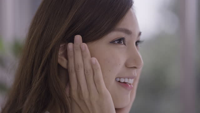 close shot of a woman touching her face with hands - skin feature stock videos & royalty-free footage