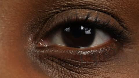close shot of a woman's left eye. - eyelash stock videos & royalty-free footage
