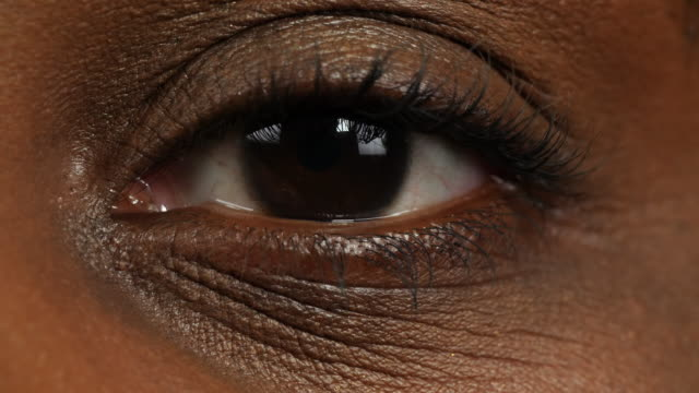 close shot of a woman's left eye. - eye close up stock videos and b-roll footage