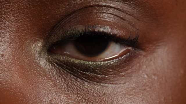 close shot of a woman's left eye. - human face stock videos & royalty-free footage