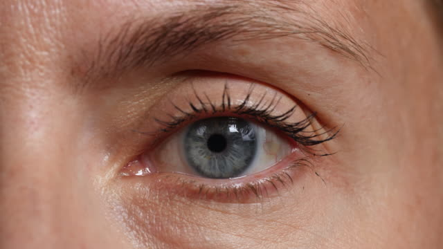 close shot of a woman's left eye. - big brother orwellian concept stock videos & royalty-free footage