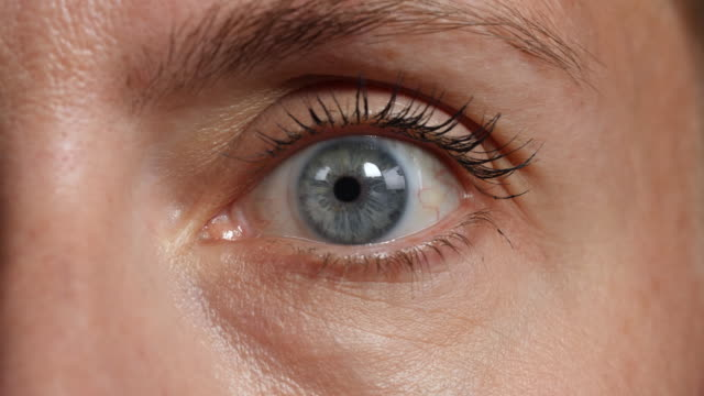 close shot of a woman's left eye. - eyelid stock videos and b-roll footage