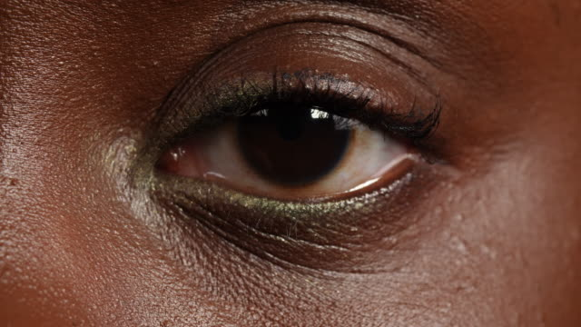 close shot of a woman's left eye. - blinking stock videos & royalty-free footage